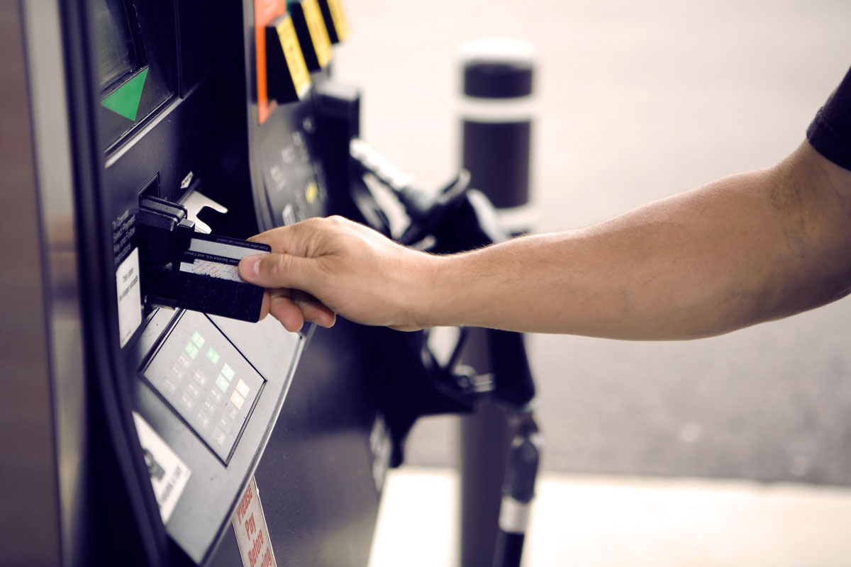 Person paying at gas pump